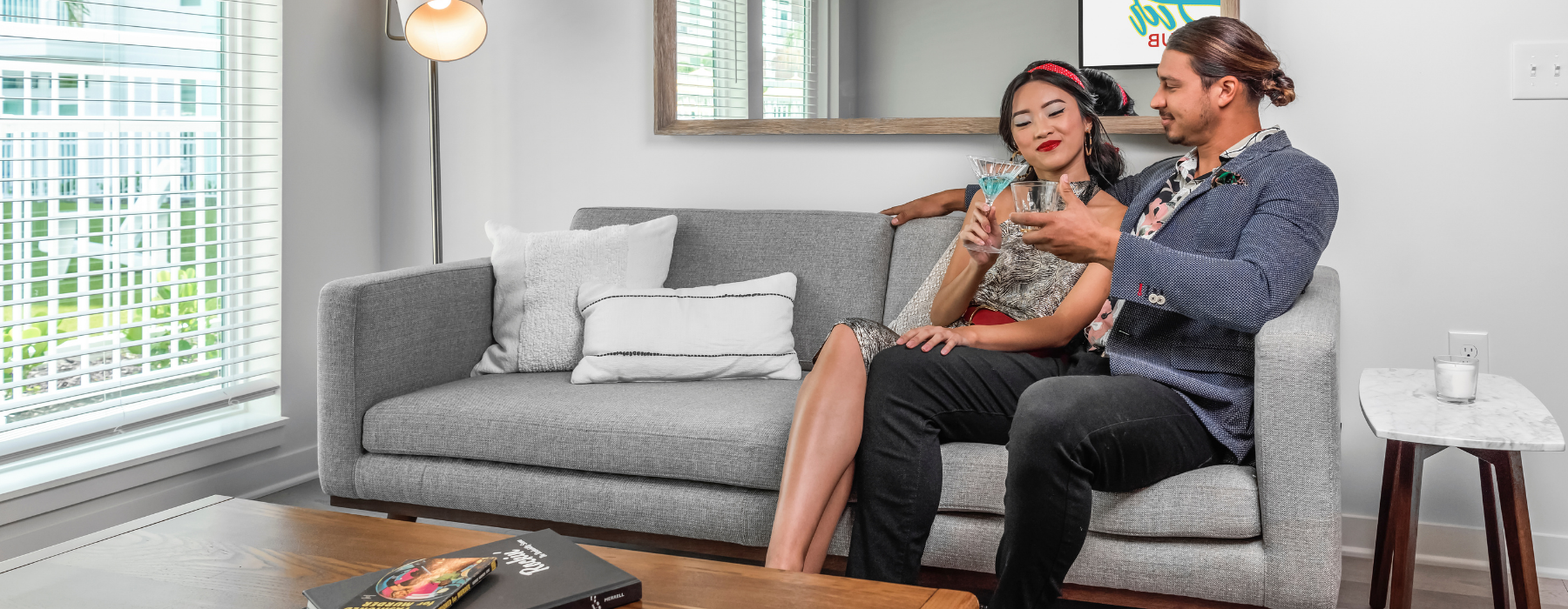 couple in vintage clothes lounging on couch